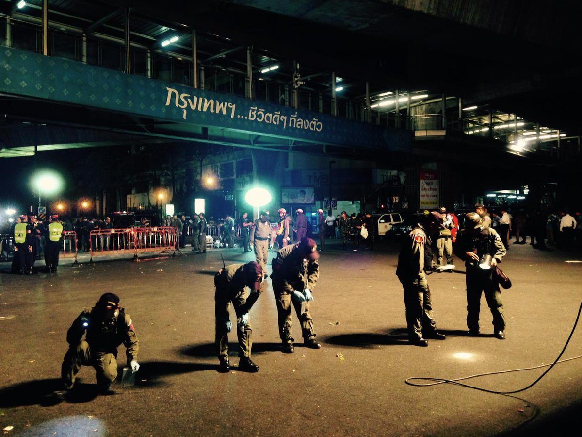 """Explosives experts comb the Bangkok blast site. The sign above says """"Bangkok - City of Life."""" http://t.co/3M1dMULvMq"""