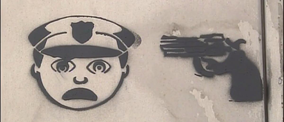 Cop-Killing emojis spraypainted throughout Houston