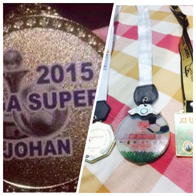 Perbandingan antara pingat johan liga super 2015 dengan pingat liga ipt