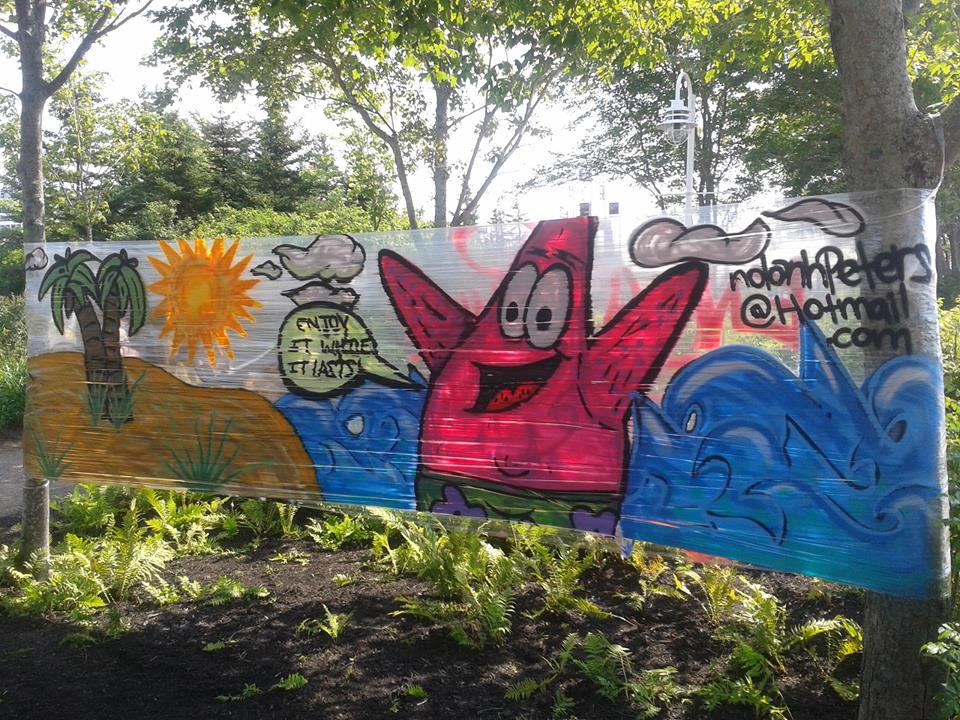 I create Graffiti art, this was painted on saran wrap with spraypaint at peaks quay #icreatepei #pei #charlottetown http://t.co/muNEujXy3p
