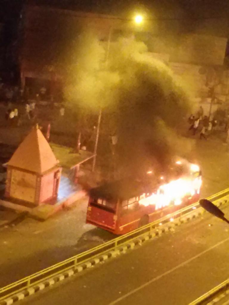 #Ahmedabad burning. :( Reports of lathicharge now. Cousin staying in Thaltej says several buses burnt. More pics. http://t.co/VwWuk2vywK