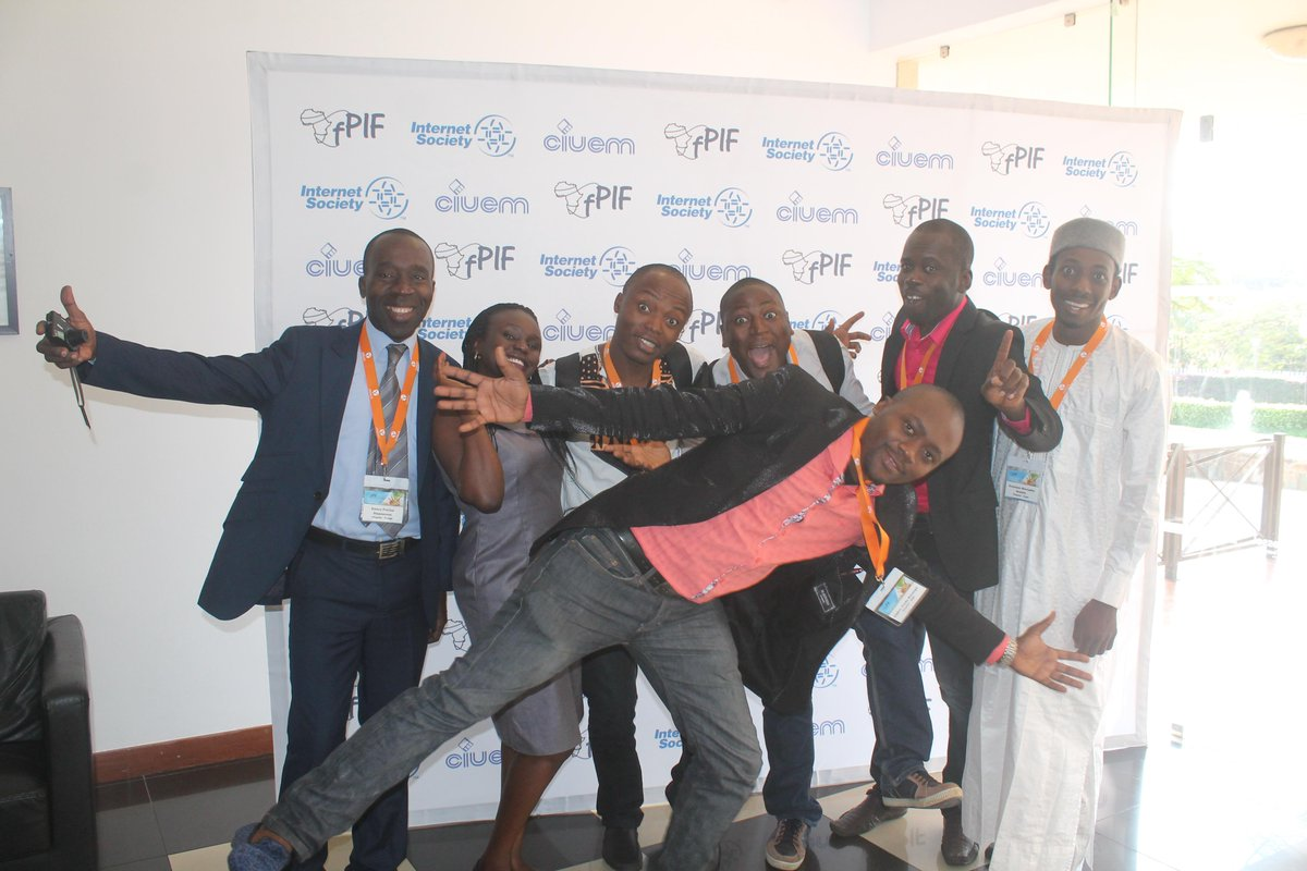 Two Cameroonians: Denis and Gabriel with some other Attendees @ AfPIF2015 Source: https://pbs.twimg.com/media/CNUUyH2WoAADMg2.jpg