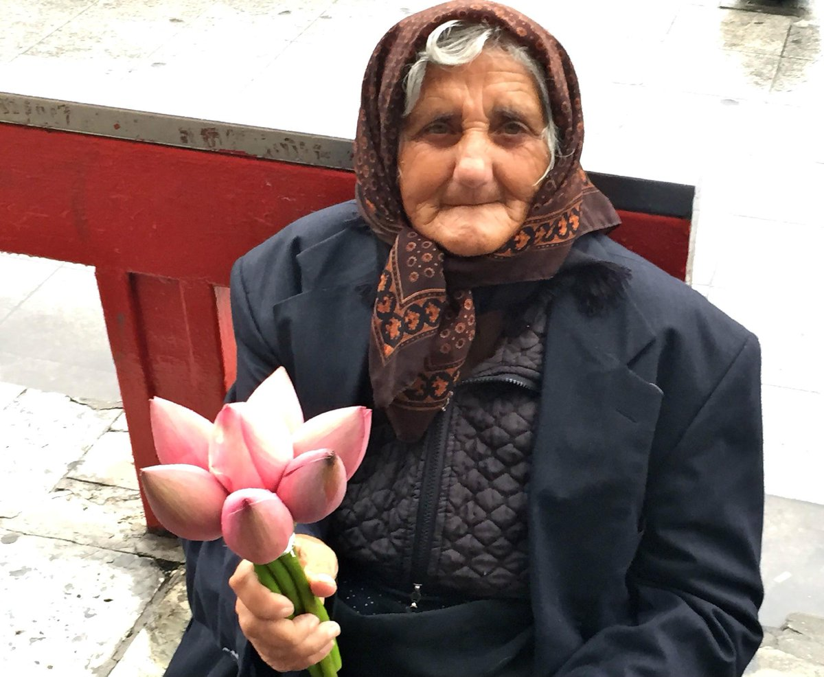 #BULGARIA  She was selling flowers in the rain. I paid for them but asked for her photo instead. #responsibletourism http://t.co/jQTcMh2xvj