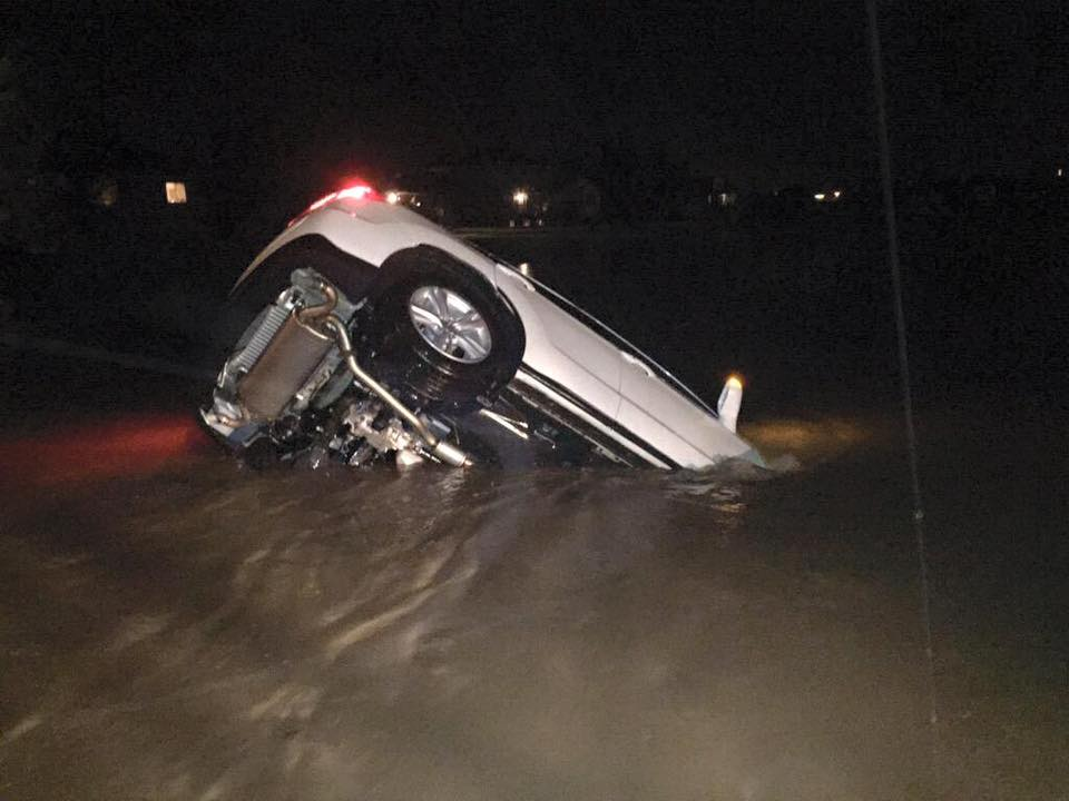 "12th Street in Sioux Falls, SD. 7-8"" rain in under an hour. Urban flash flooding. Lee Johnson photo. http://t.co/wAg6OqCG85"