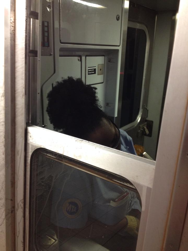 E train conductor taking a well deserved (I guess?) nap at 8th stop. @MTA http://t.co/zHB72TvRUk