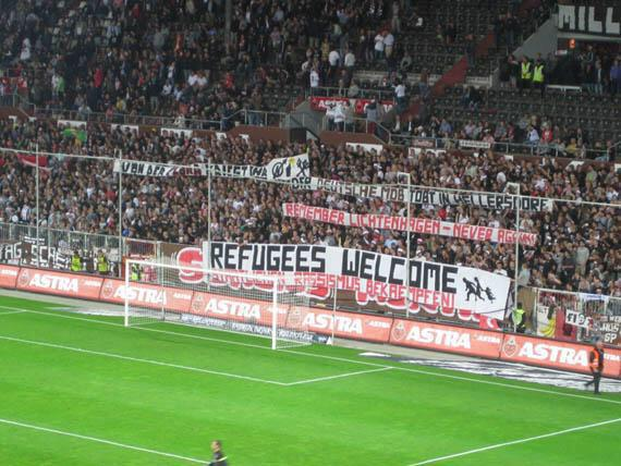 """REFUGEES WELCOME"". Banners draped in Germany's football stadiums http://t.co/h8t8CKLxgp (via @JFXM) Popular sentiment ahead of politicians."