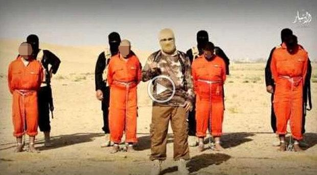 Warning graphic content: isis killers hang prisoners over a fire and