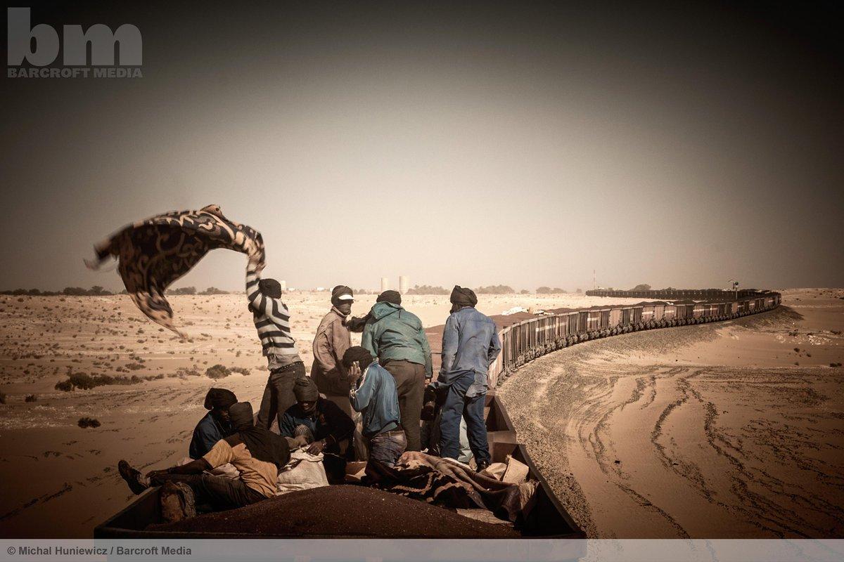 People ride the world's longest cargo train on its journey through the Sahara.  ©Michal Huniewicz/Barcroft Media http://t.co/qU7nxvR8EU