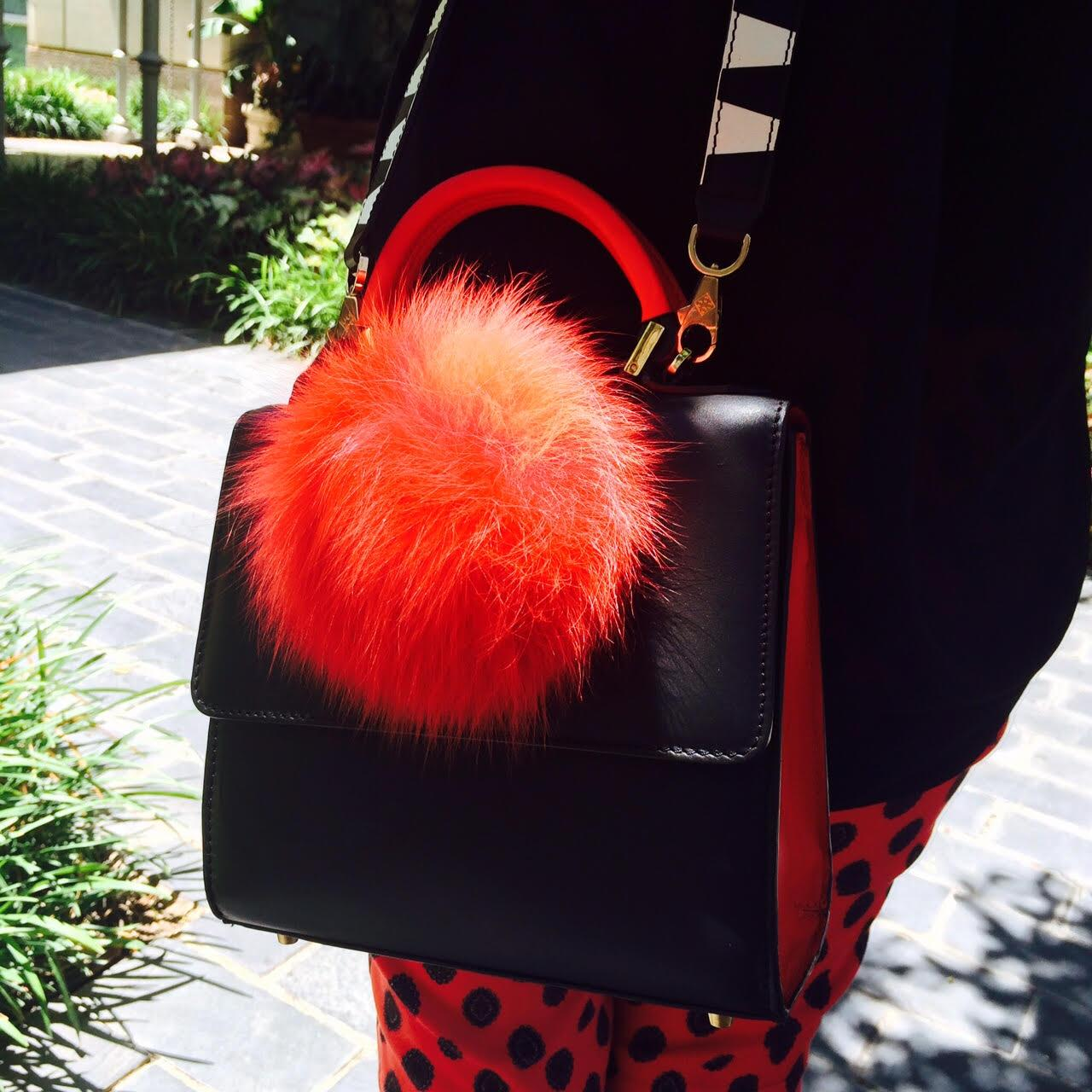Because red is our color of choice this fall. Crushing on this @LPJparis pom pom handbag: http://t.co/qoARDFtXMx http://t.co/mxnKV1XRYE