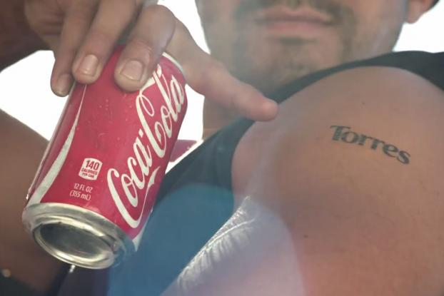 Coke emblazons cans with transferable tattoos of last names http://t.co/f14Jc7zcVc http://t.co/s1HINk1H0Z