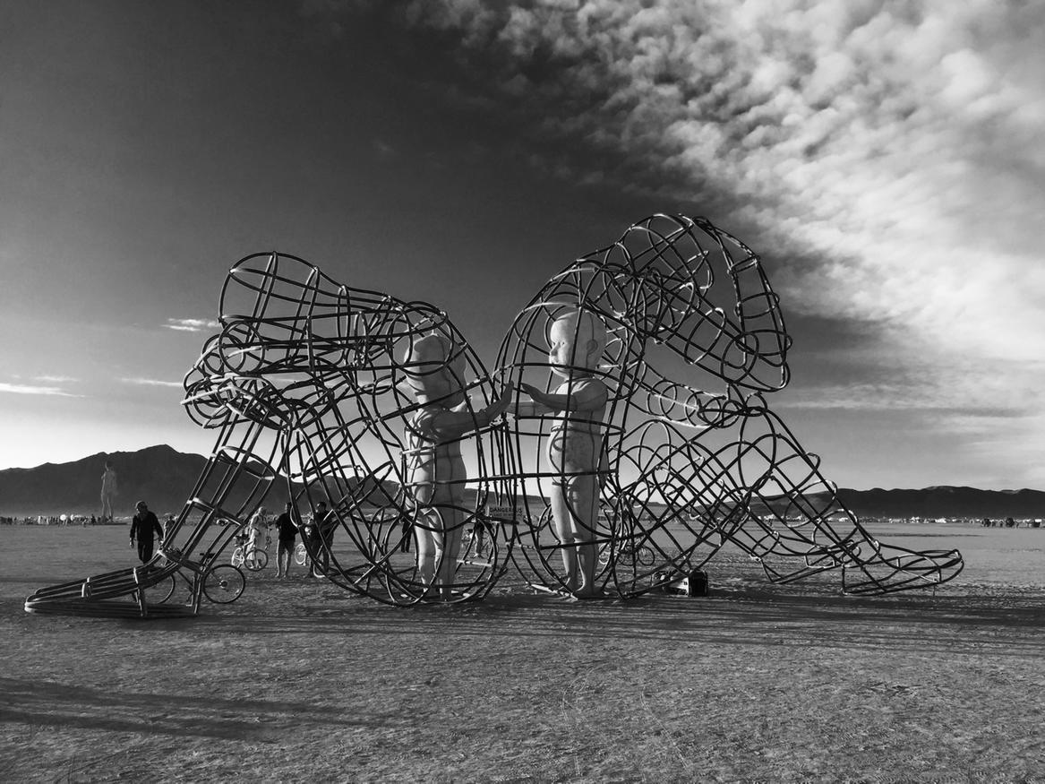 My favorite piece of art at @burningman. Two children inside two sad adults. http://t.co/2pp9MsjdY7