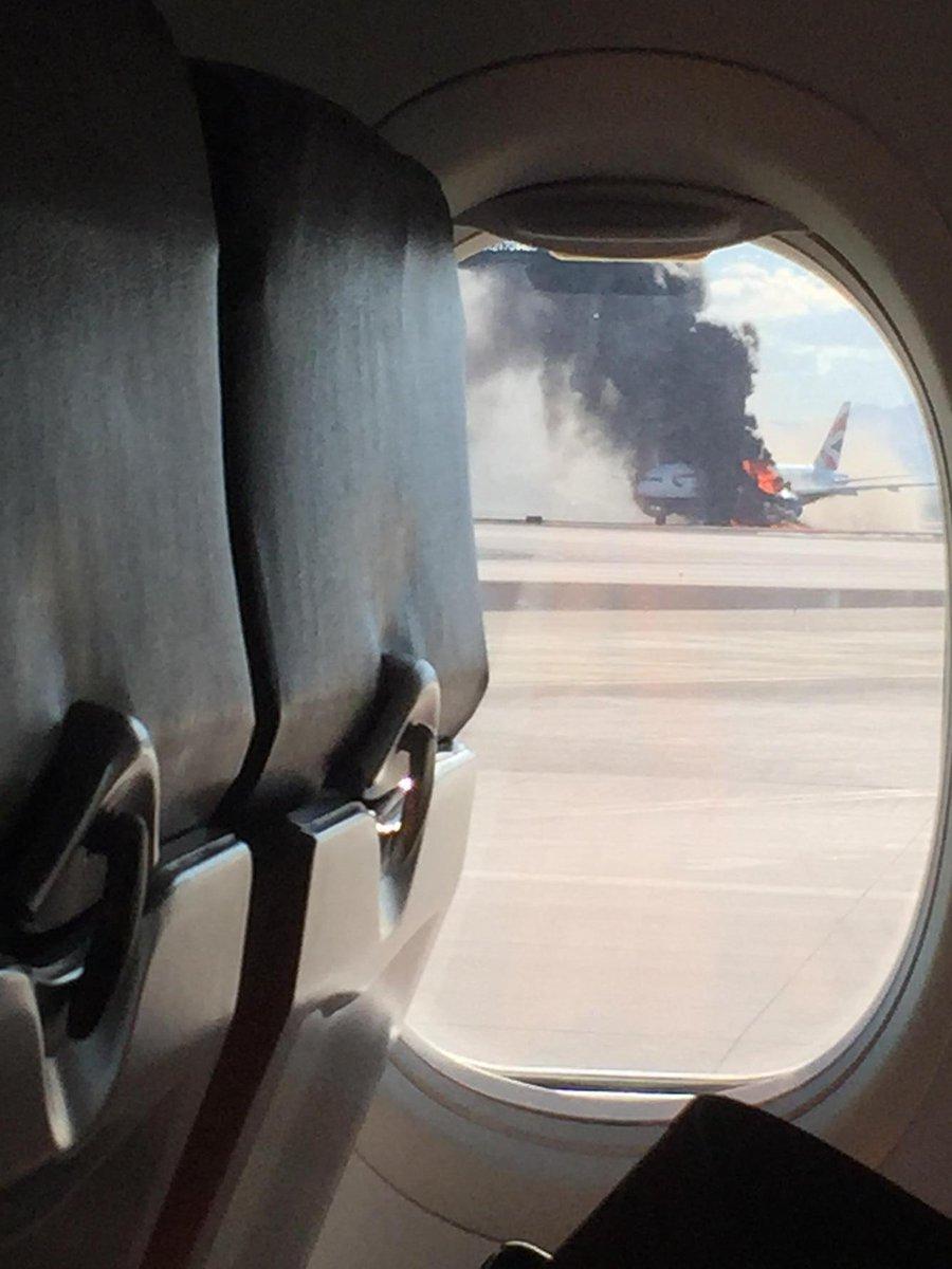 Just landed in Vegas to see this...plane on fire on the Tarmac...people still onboard and running off! http://t.co/ul10hFFw9j