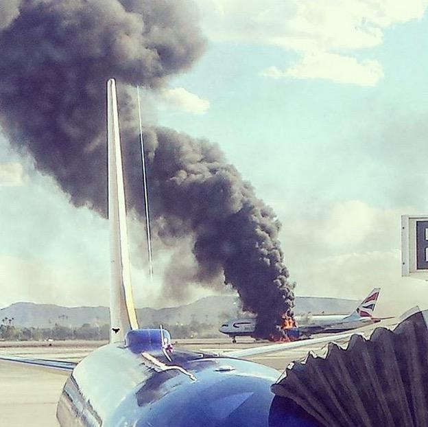 LIVE on @Banjo: #Plane catches #fire on tarmac at #LAS airport #Vegas http://t.co/yKLl1lX0Ga (