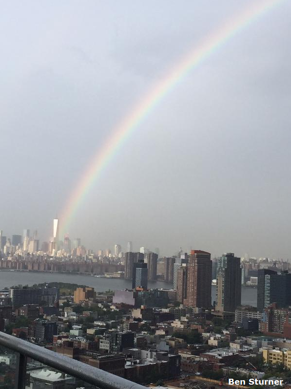 On the eve of the 14th anniversary of the 9/11 attacks, a rainbow appears to emerge from One World Trade Center