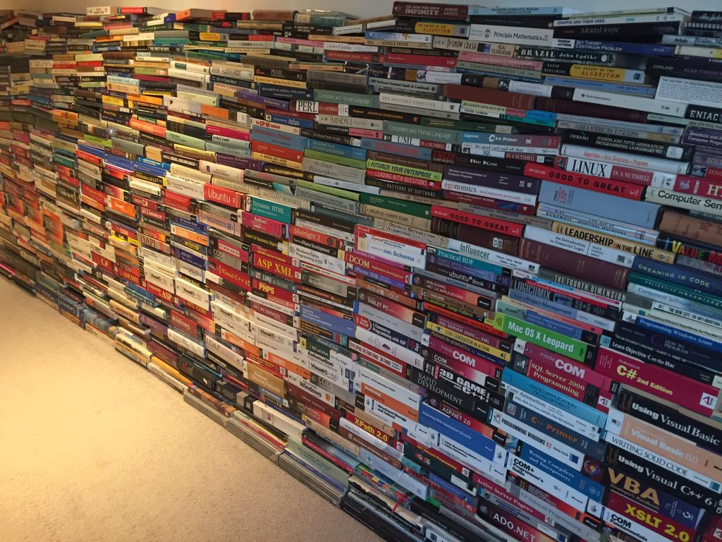 "This is the ""cold storage"" of books at the home of the smartest dev I've ever worked with http://t.co/6NsSB4iI9g"