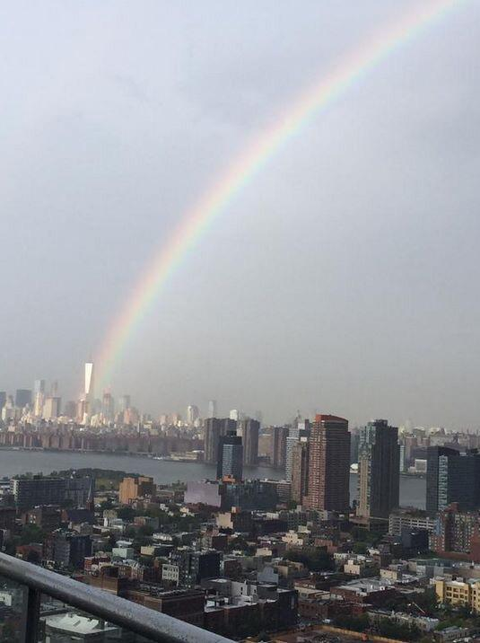 A rainbow emerged earlier today in NYC, emerging from the World Trade Center (photo by Ben Sturner). #NeverForget