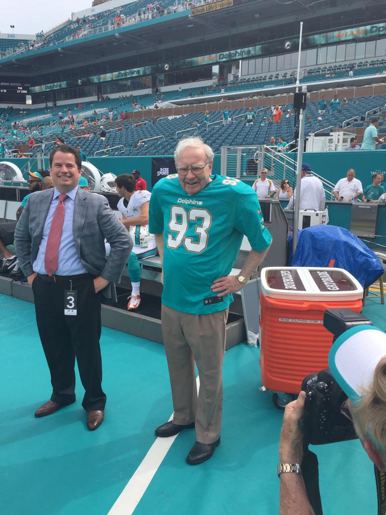 Warren Buffett is currently on Dolphins' sideline... wearing a Suh jersey... and shoulder pads. Seriously. http://t.co/RF1SekFQkF