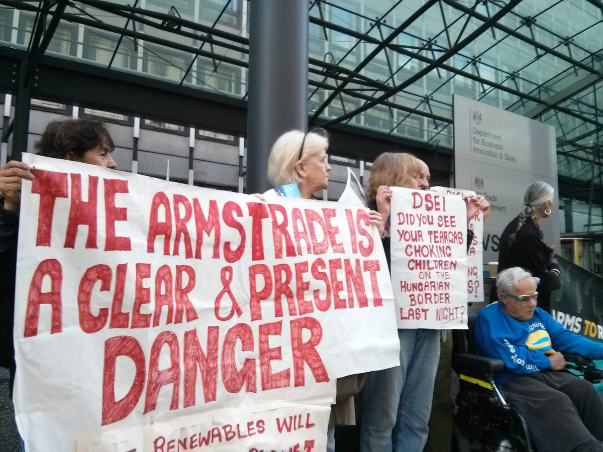 Demonstrators against arms trade fair in London, England