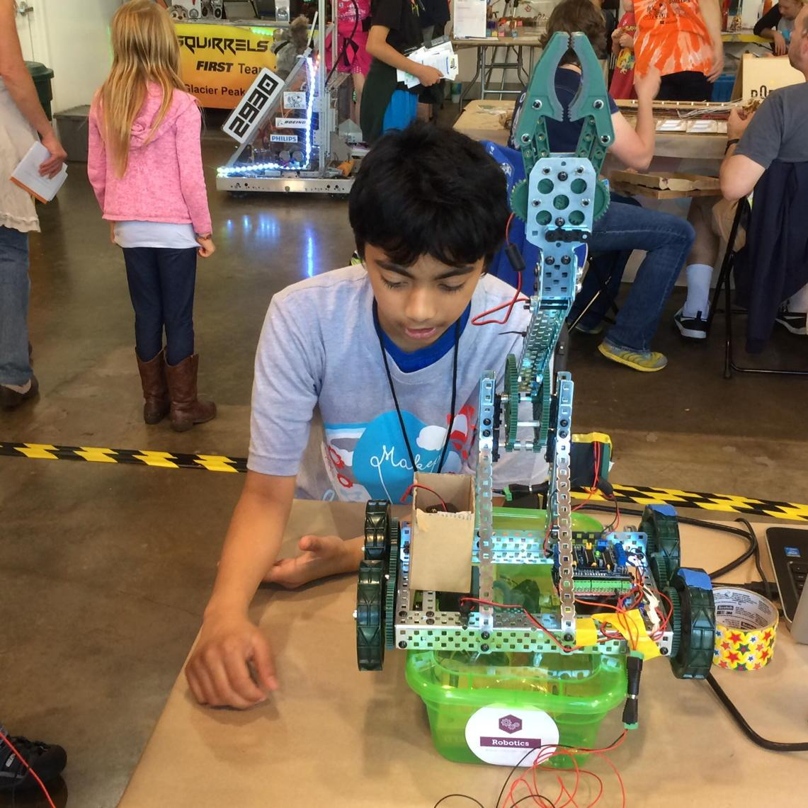 11 y/o kid built a mind control interface for robot. Luckily it's not subversive like a clock. Seattle maker fair. http://t.co/vpQDD4uedV