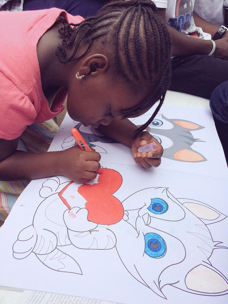 Blessing working hard on her coloring skills. #NVDay15 #ReadToAChild @whatawomanorg http://t.co/300TJFzaVa