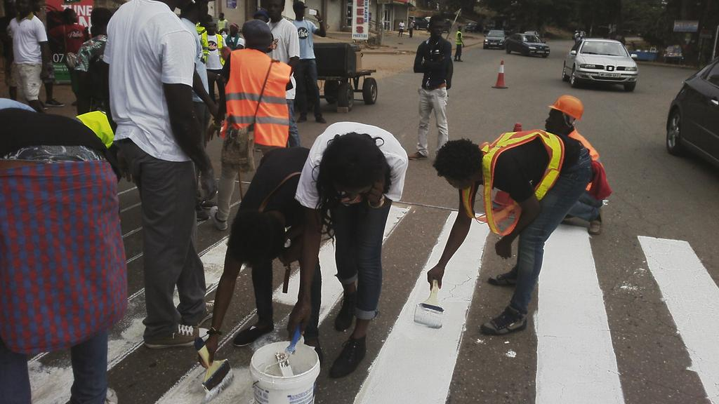 Girls on duty @pilolo_gh Zebracrossing Repainting @paintermain  @lc_akoto @myraclera #Pilolo #NVDay2015 http://t.co/l47M39eXBz