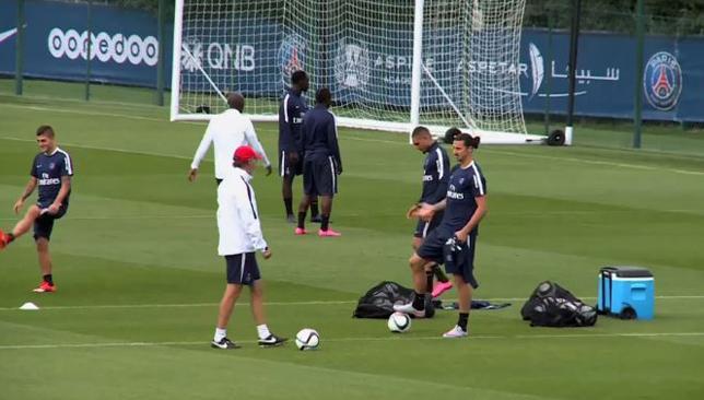 Still got it: PSG manager Laurent Blanc plays a crossbar ...