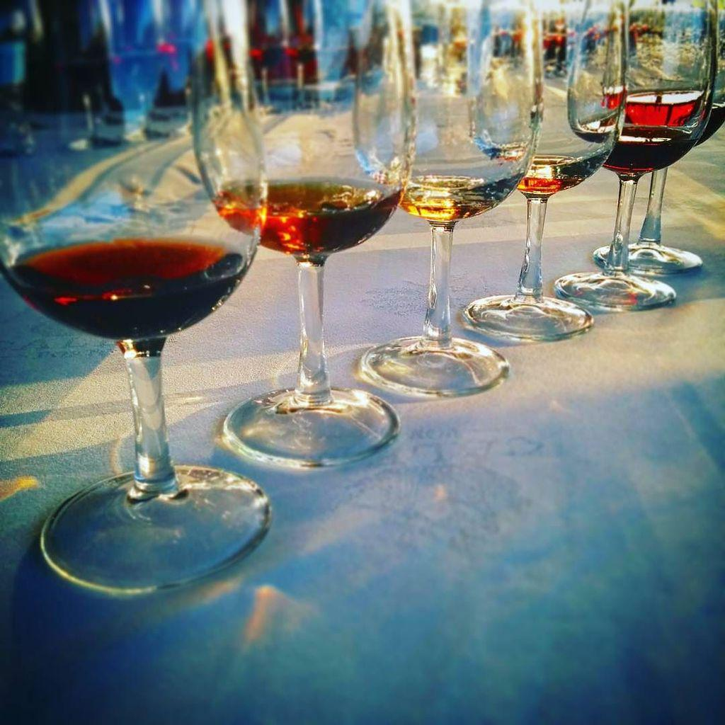 Hundreds of years of wine in these glasses. Lucky me! #douro15 #portugal #portwine http://t.co/3KzDqjUp4t