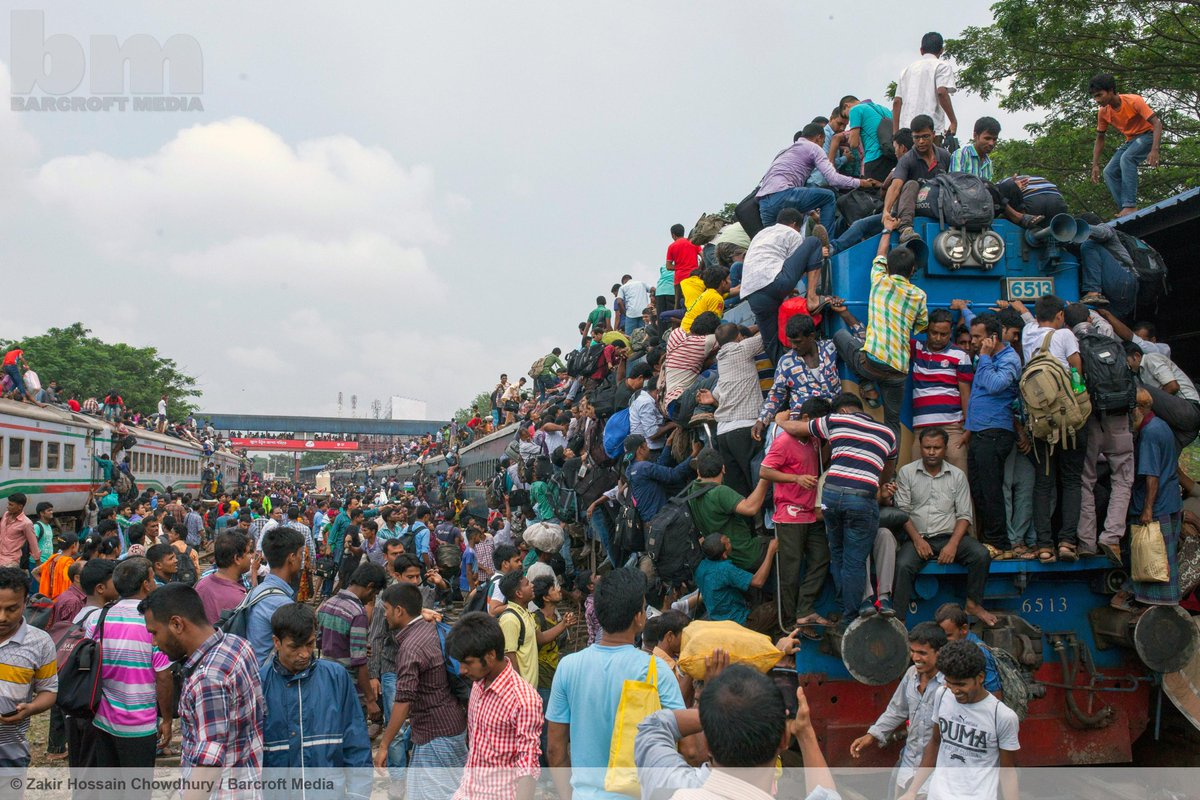 Crowds are forced to ride on the roof of an overcrowded train in Dhaka.  ©Zakir Hossain Chowdhury/Barcroft Media http://t.co/w3Z2jSsAiS