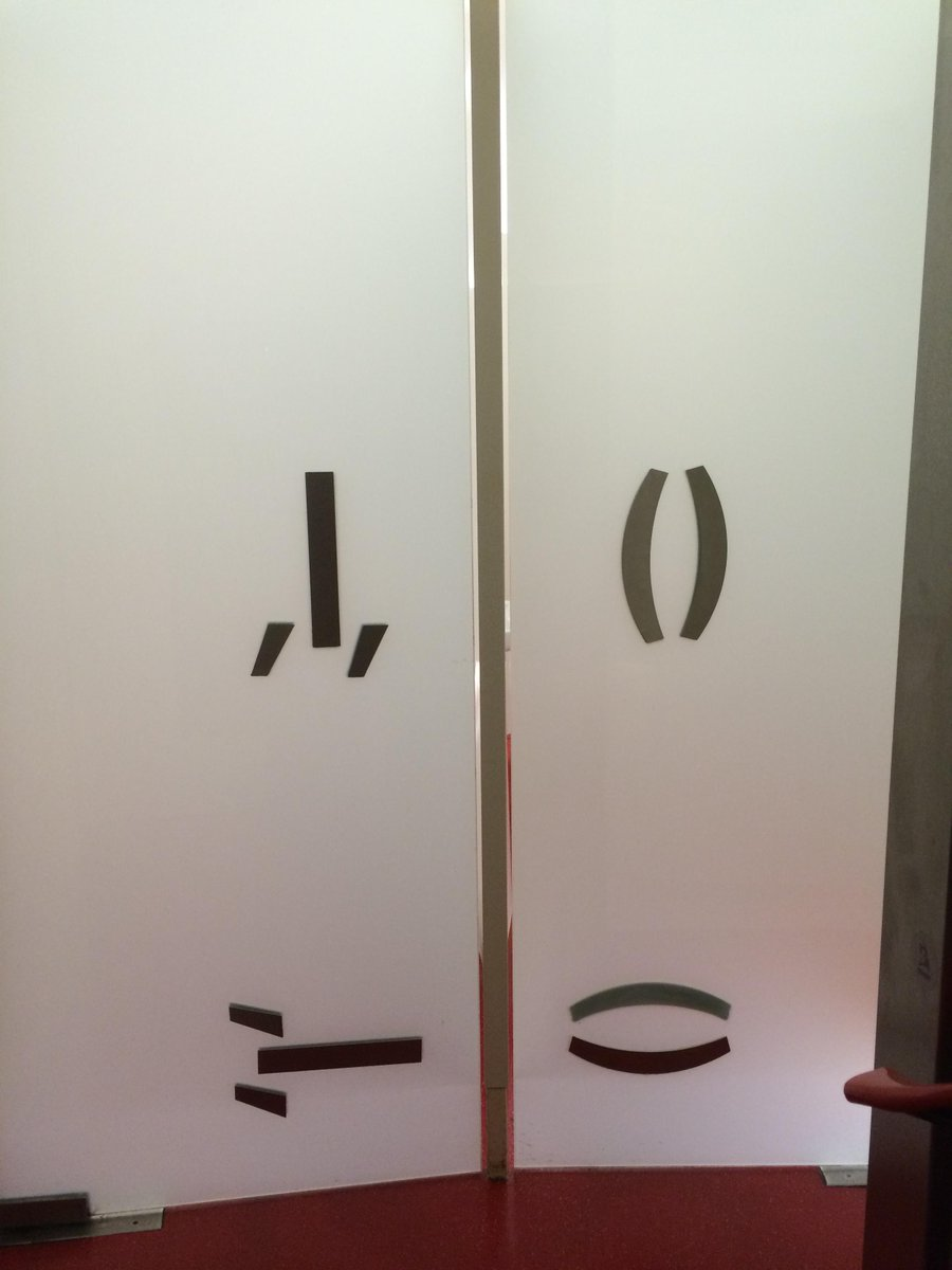 These are toilet doors. Initially obscure then alarmingly explicit. Vienna in a nutshell. http://t.co/6UA2oiZTX7