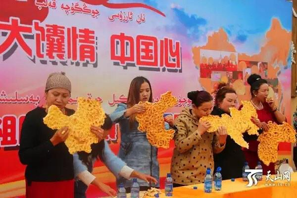 National Day competition in Xinjiang: biting out a map of China out of naan. Cannot make this up. #China http://t.co/r2Lpu0YHfZ