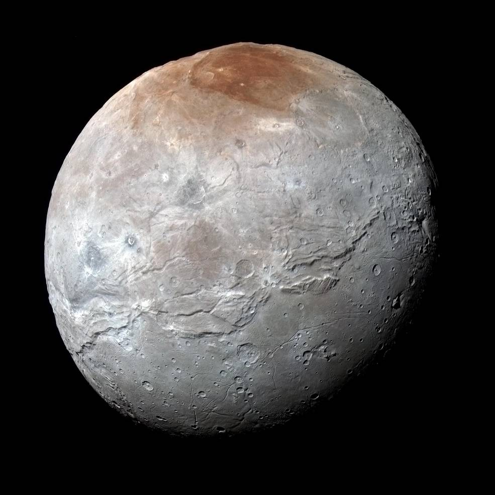 Pluto's Big Moon Charon Reveals a Colorful and Violent History http://t.co/PRponhoXP5