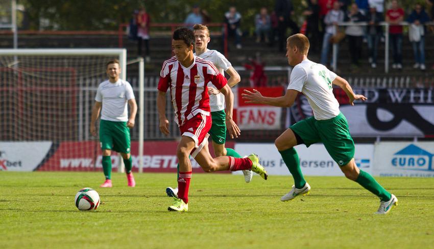 Kostadinov dribbles the ball