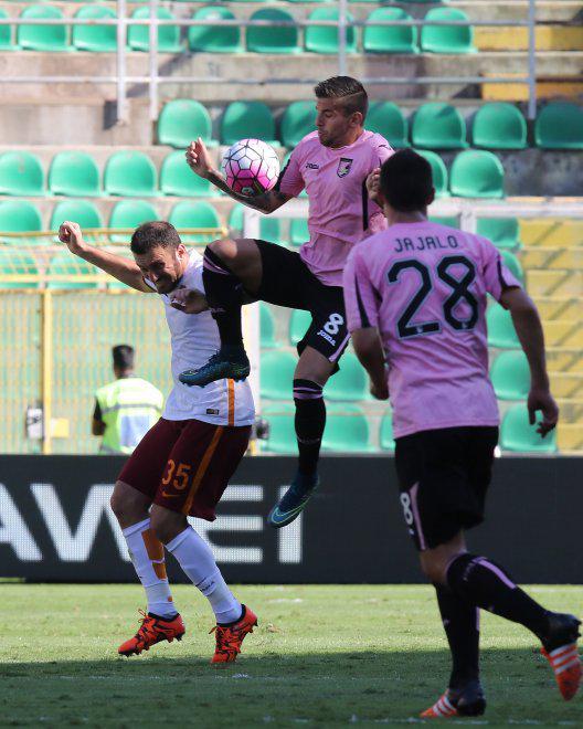 Trajkovski tries to control the ball