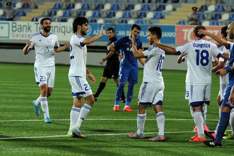 Dimitrovski and teammates celebrate after a goal