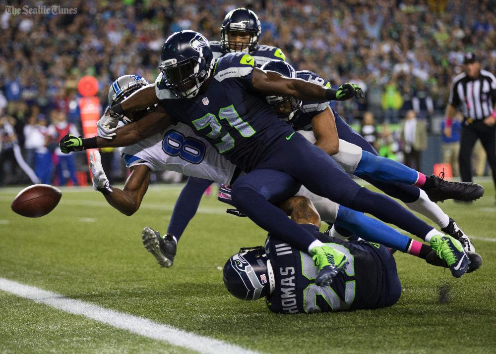 #Seahawks Kam Chancellor hits the ball free from Lions Calvin Johnson. #DETvsSEA (@deanrutz) http://t.co/GCahfg9ni3 http://t.co/0rDwZSaQHL