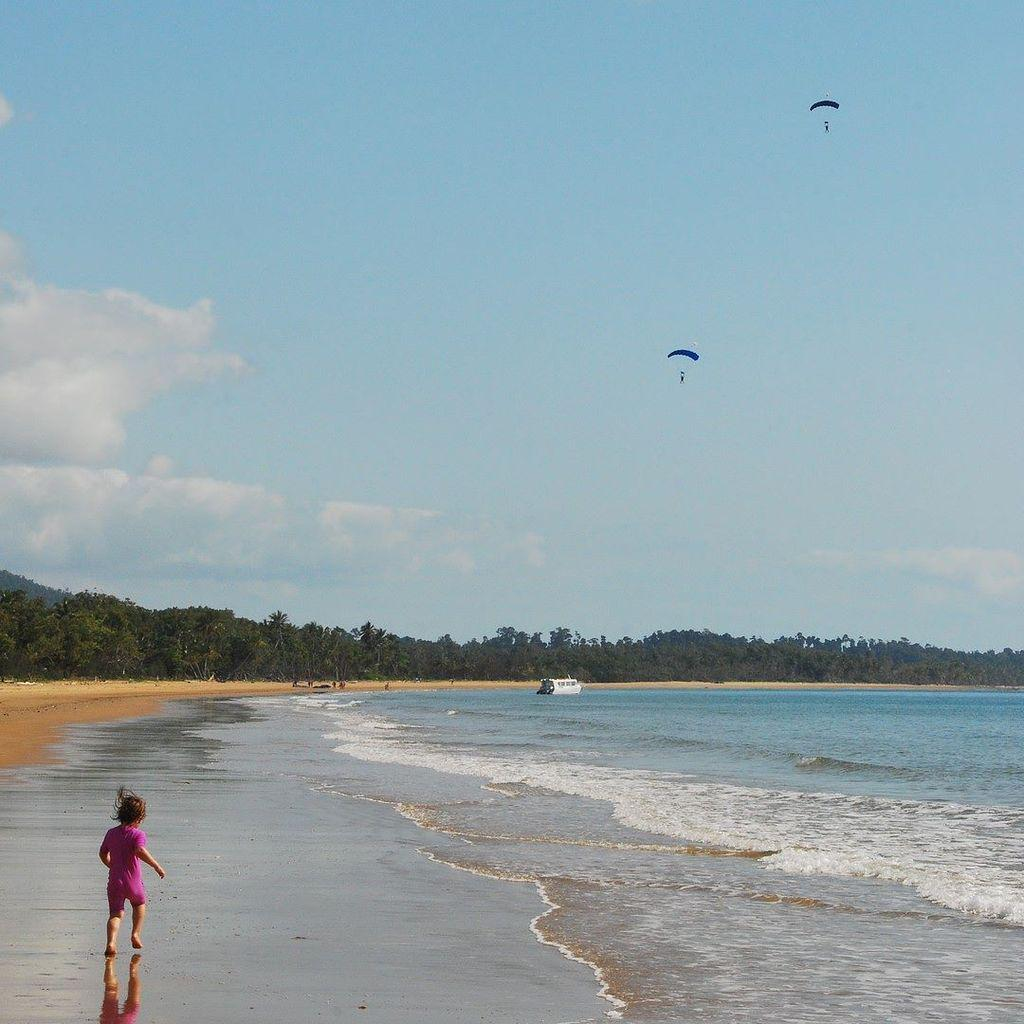 Parachutes landing at Mission Beach, @queensland, @australia @tropicalnorthqueensland #travel #adventure http://t.co/5cPYndHFtE