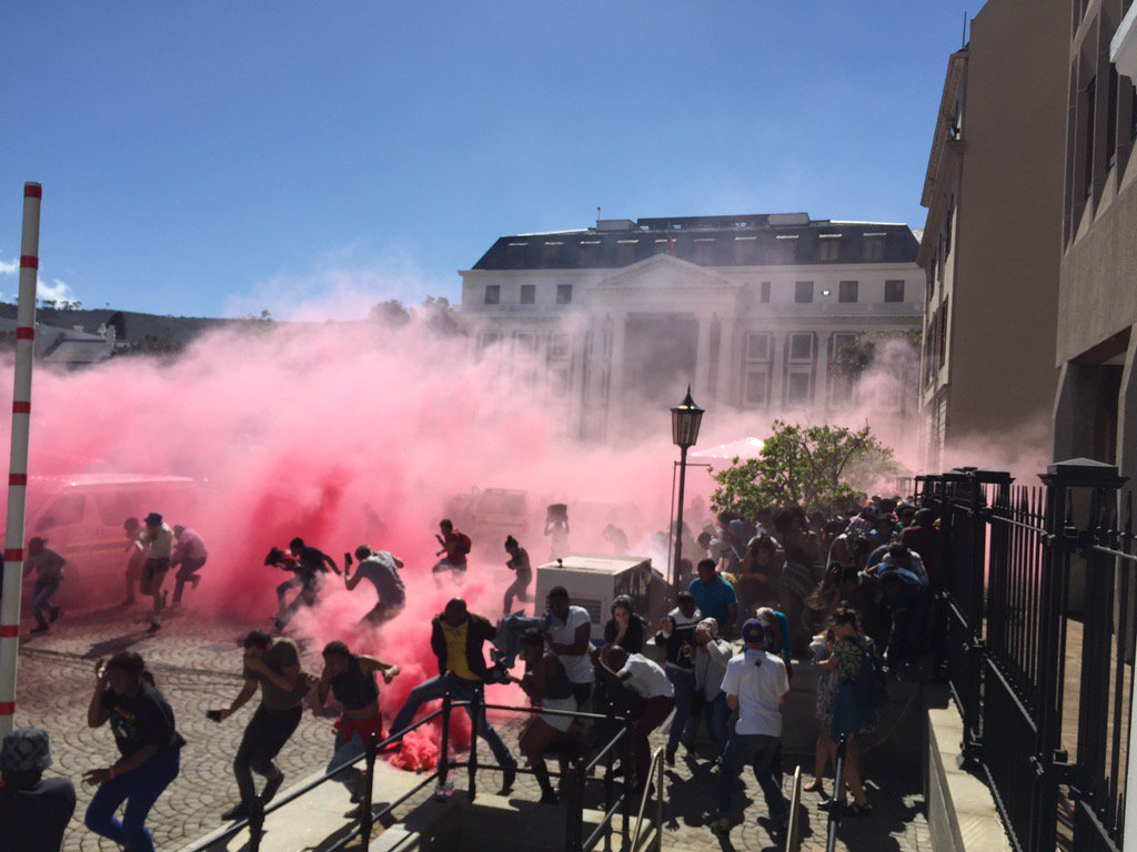 ".""@LionelAdendorf: Chaotic scenes outside #parliament. Police shooting teargas, stun grenades. #FeesMustFall https://t.co/YIa4KM1Jcu"""