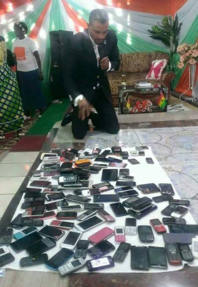 Pastor praying against spirits of Facebook & WhatsApp inside phones. Someone tell him they're apps he can uninstall. http://t.co/l1LWHga86o