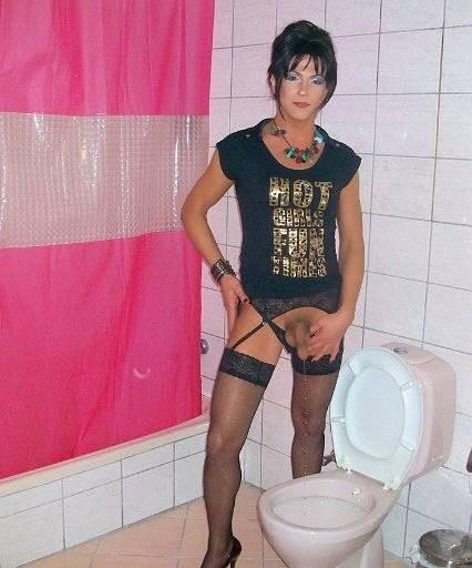 Tranny in stockings pissing