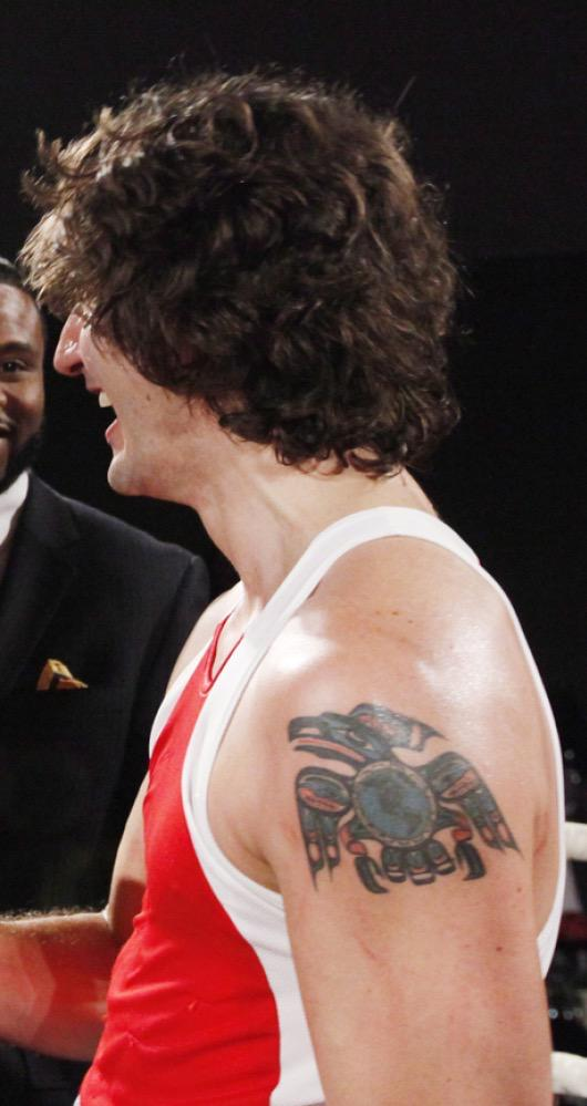 side view of Canada's Trudeau's upper left arm tattoo of an eagle