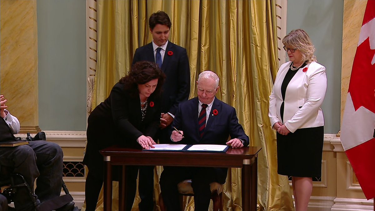 The Governor General is pictured signing the oath books. Justin Trudeau is now officially Prime Minister of Canada.