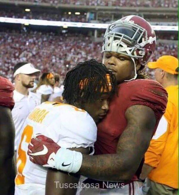 Our photographers did a great job here. Derrick Henry and Alvin Kamara sharing a moment bigger than any game. https://t.co/8IYkSVGs3z