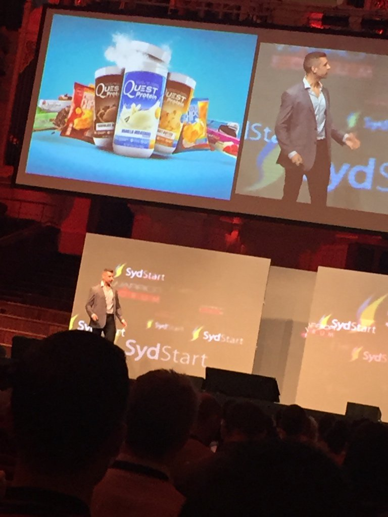 CMO of @QuestNutrition, Nick Robinson on stage at #SydStart. Their protein bars are actually my favorite! https://t.co/waK6AqH031