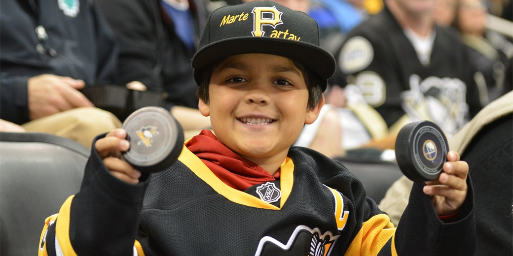 Mean old man steals puck from little Penguins fan