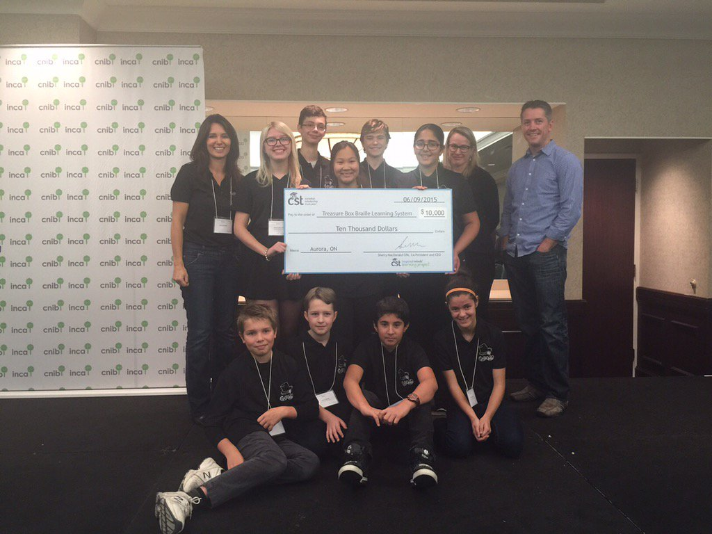 The Classy Cyborgs and the giant CST Cheque at the CNIB 2015 Conference.