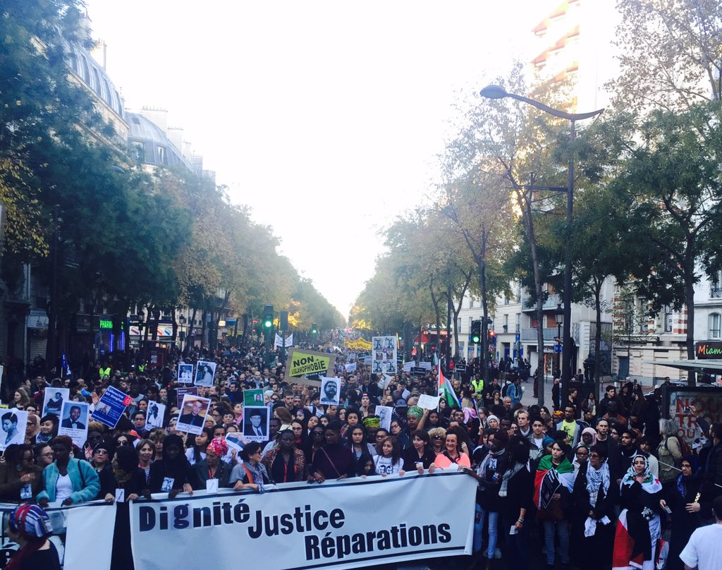 """Crowds as far as the eye can see! Feminists lead """"We won't forget!"""" colonialism, slavery #MarcheDeLaDignite #Paris https://t.co/hAulbiIozM"""