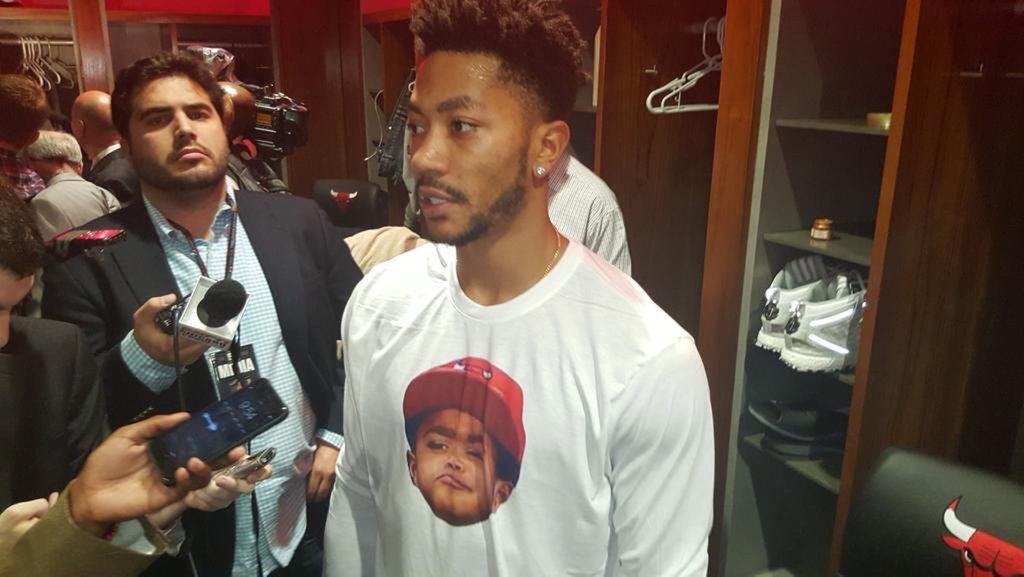 Derrick Rose wore a magnificent shirt with his meme-son's face on it