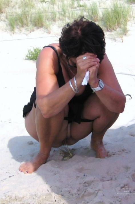 Girls peeing at the beach videos