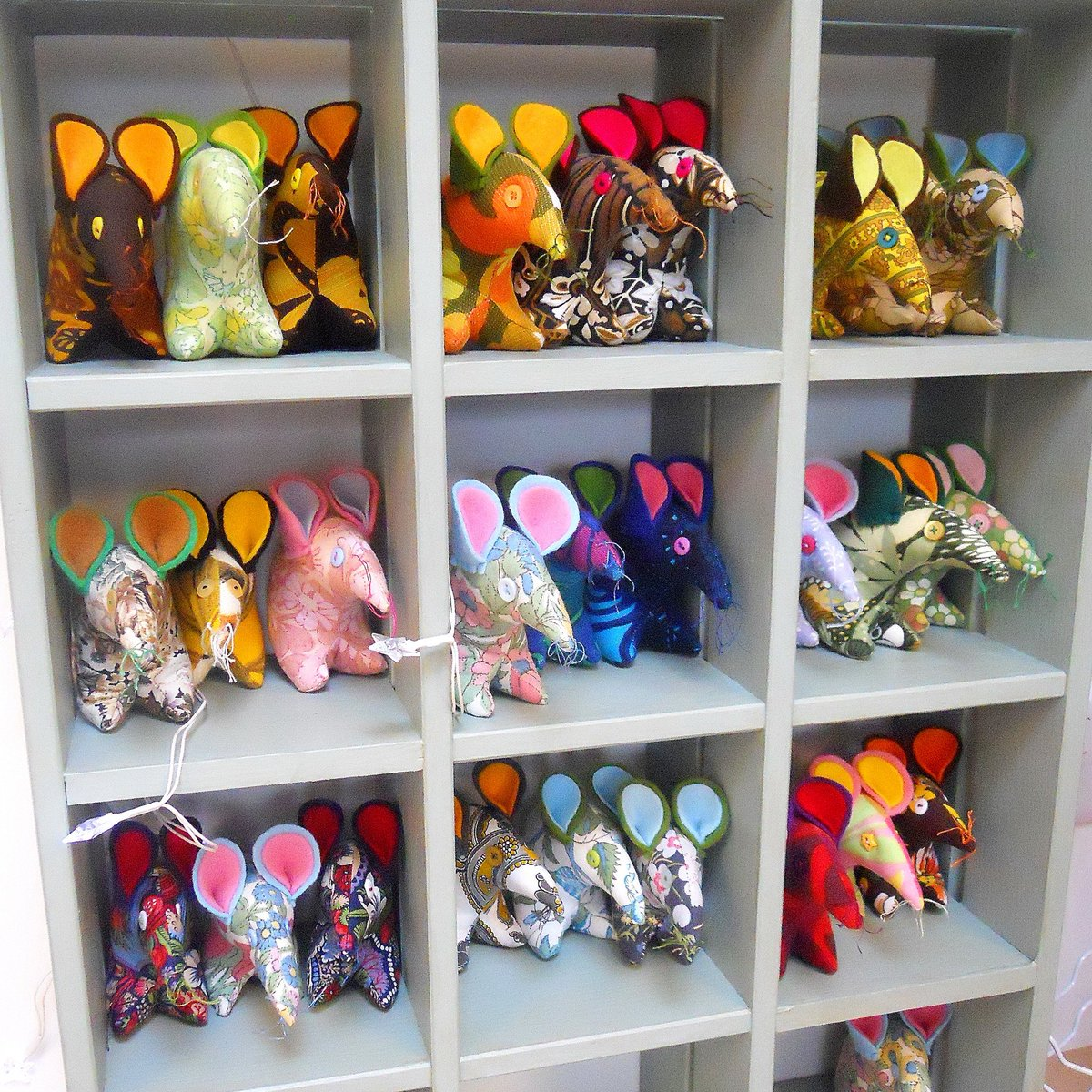 My current stock of mice are now cosily housed in their special cubby hole shelves in my studio ! #vintage #handmade https://t.co/csl7ppk6QH