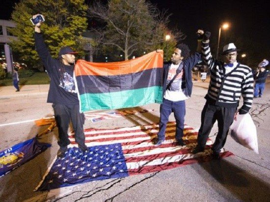 Leftists stomp on American Flag raise Black Liberation flag